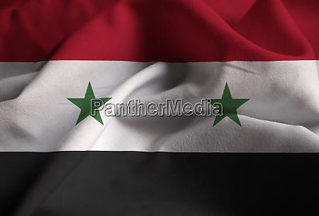 closeup of ruffled syria flag syria
