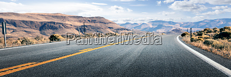 long road through desert empty street