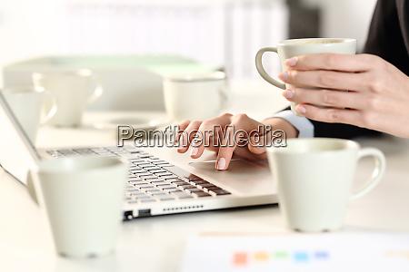 executive hands overworking taking caffeine drink