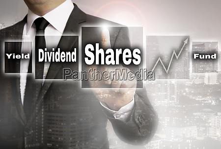 shares trader with city background concept