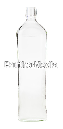 empty clear whiskey bottle isolated on
