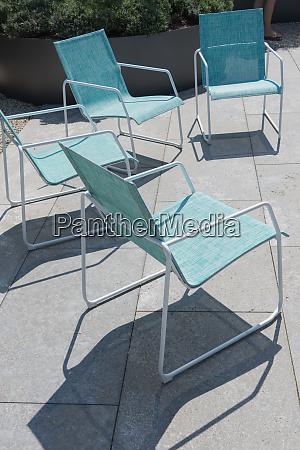 four seats in a modern garden
