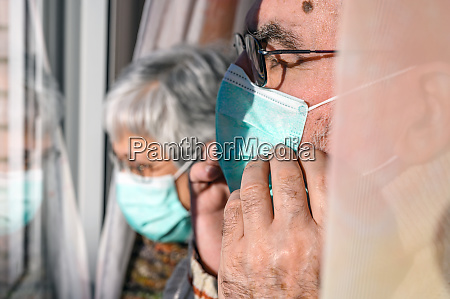 senior couple with protective face masks