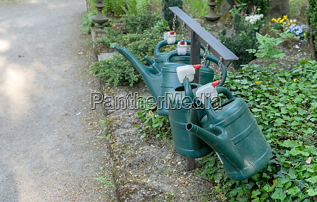 green watering cans