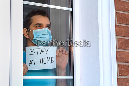 man in medical mask stay at