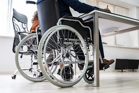 disabled businessman sitting on wheelchair