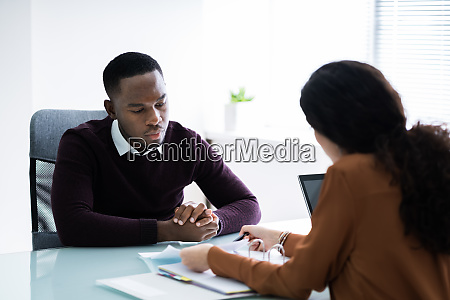 financial advisor discussing invoice with her