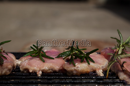 pork steaks with rosemary grilling on