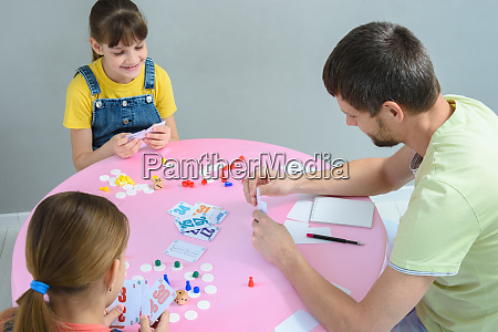 family plays board games at the