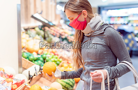 woman shopping in supermarket during coronavirus