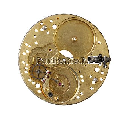 dismantled clockwork mechanism