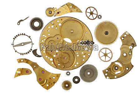 disassembled clockwork mechanism various part