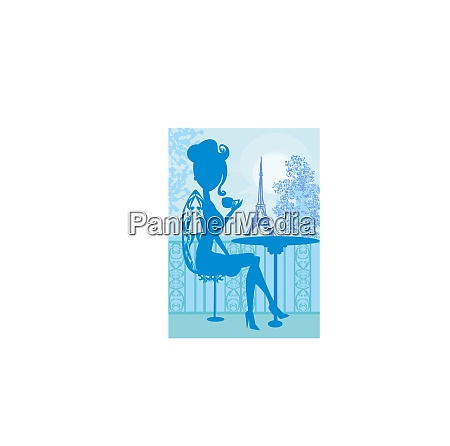 elegant girl in the parisian cafe