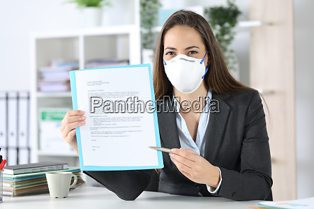 executive with mask showing contract at