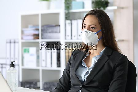 pensive executive wearing mask looking away
