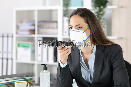 executive with mask using voice recognition