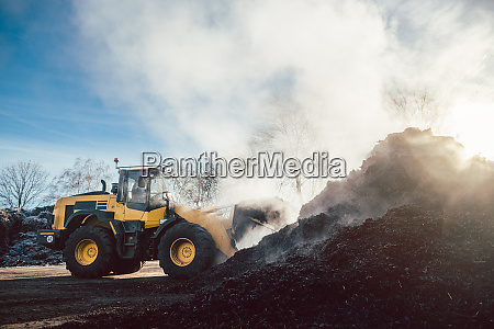 bulldozer at heavy earthworks in biomass