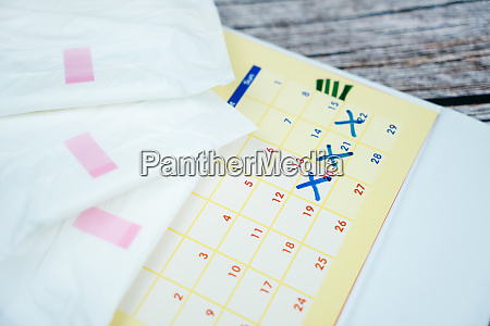 stacked sanitary napkin pad on calendar