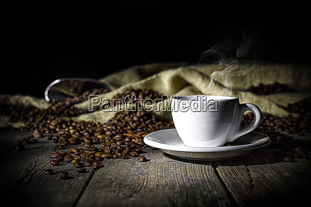 steaming cup of coffee on wooden