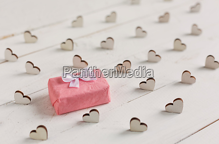 gift box and decorative hearts on