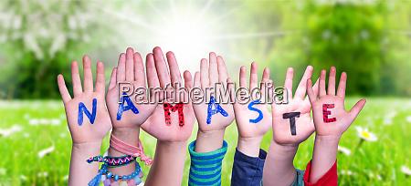 children hands building word namaste means
