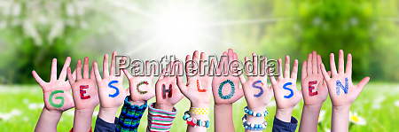 children hands building word geschlossen means
