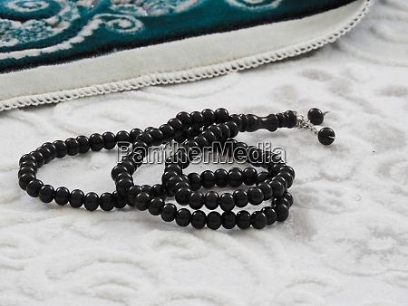 green prayer rug and rosary green
