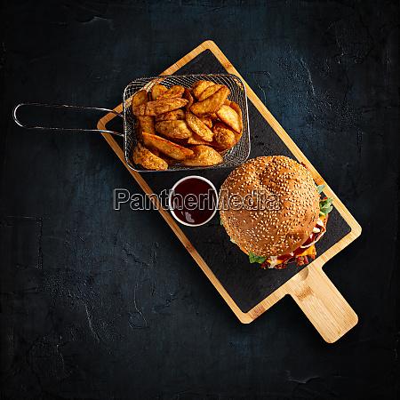 tasty burger and golden potatoes