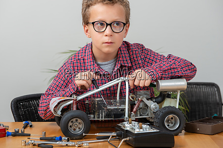 little boy repairing model radio controlled