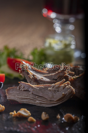 grilled duck on a wooden cutting