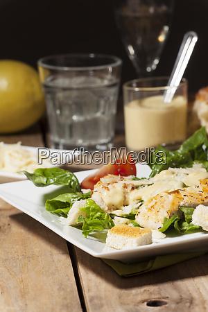 ceasar salad on rustic wood