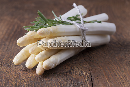 bunch of white asparagus on wood
