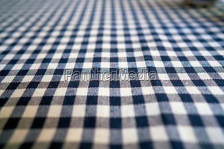 checked tablecloth on a table in