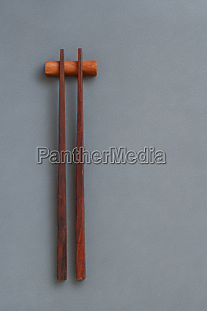 wooden chopsticks on gray background top