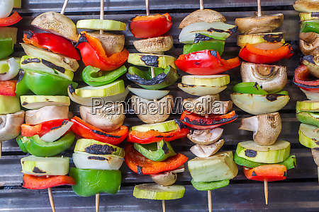 vegetable skewers grilling on the barbecue