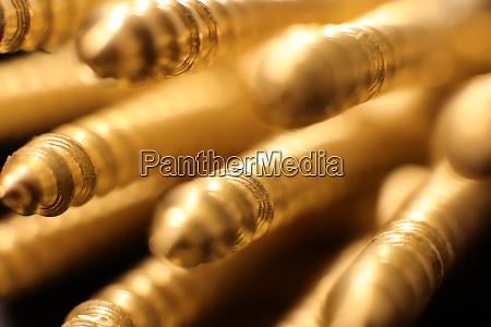 golden screws background macro closeup public