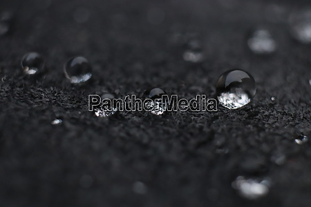 water drops on black leather wet