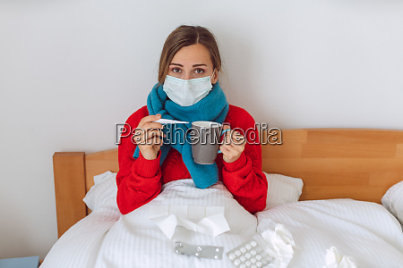 woman contracted covid 19 measuring fever