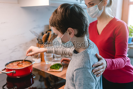 mother and son cooking at home