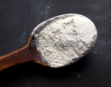 white wheat flour in a wooden