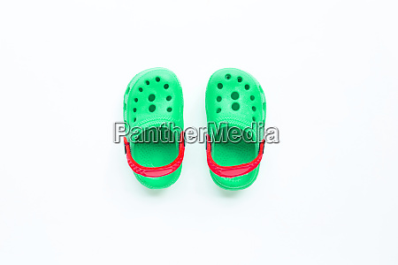 green childrens rubber sandals on white