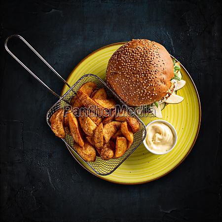 vegetarian burger and golden potatoes