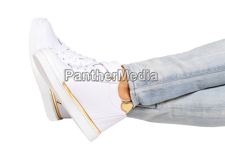 women legs in jeans and sneakers