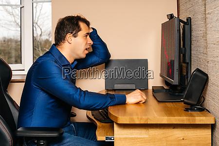 broken businessman in disbelief looking at