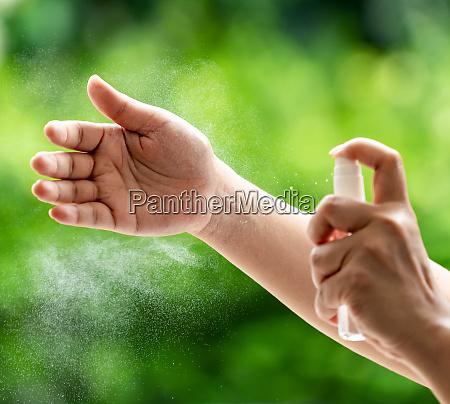 spraying hand clean