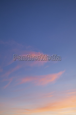 pink sunset clouds with blue skies