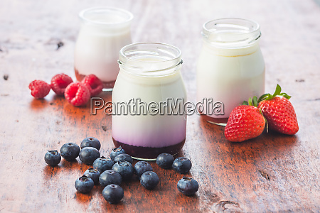 white fruity yogurt in jar and