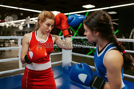 women in red and blue gloves
