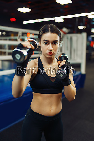 woman doing exercise with dumbbells box