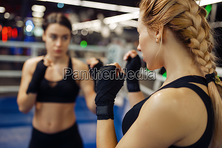 women in boxing bandages on the